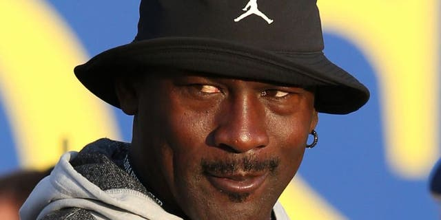 Sep 27, 2014; Auchterarder, Perthshire, SCT; NBA legend Michael Jordan watches the players tee off on hole one during day two of the 2014 Ryder Cup at Gleneagles Resort - PGA Centenary Course. Mandatory Credit: Brian Spurlock-USA TODAY Sports