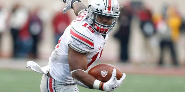 Oct 3, 2015; Bloomington, IN, USA; Ohio State Buckeyes running back Ezekiel Elliott (15) runs with the ball against the Indiana Hoosiers at Memorial Stadium. Ohio State defeats Indiana 34-27. Mandatory Credit: Brian Spurlock-USA TODAY Sports