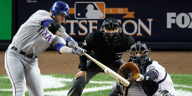 Oct. 18: Rangers' Josh Hamilton hits a two run home run off New York Yankees starting pitcher Andy Pettitte in the first inning of Game 3 of the ALCS, in New York.