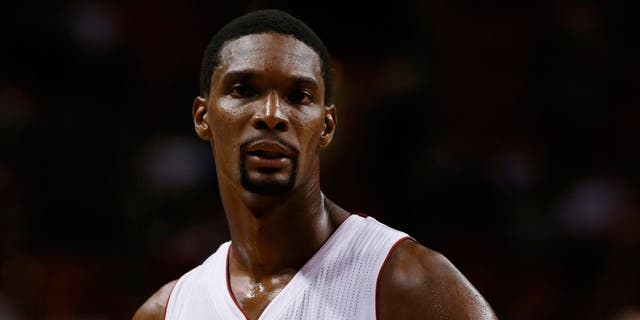 Oct 7, 2014; Miami, FL, USA; Miami Heat forward Chris Bosh (1) in the first half of a game against the Orlando Magic at American Airlines Arena. The Magic won 108-101in over time. Mandatory Credit: Robert Mayer-USA TODAY Sports