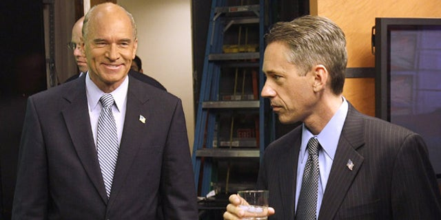 Oct. 13: Republican Jeff Perry, right, and Democrat Bill Keating prepare to debate in Newton, Mass.