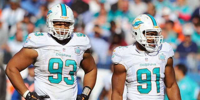 Oct 18, 2015; Nashville, TN, USA; Miami Dolphins defensive tackle Ndamukong Suh (93) and defensive end Cameron Wake (91) during the second half against the Tennessee Titans at Nissan Stadium. The Dolphins won 38-10. Mandatory Credit: Christopher Hanewinckel-USA TODAY Sports