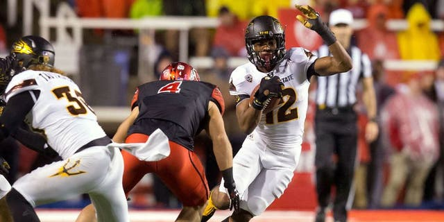 Oct 17, 2015; Salt Lake City, UT, USA; Arizona State Sun Devils wide receiver Tim White (12) runs after receiving a kickoff as Utah Utes defender Austin Lee (4) moves in for the tackle during the second half at Rice-Eccles Stadium. Utah won 34-18. Mandatory Credit: Russ Isabella-USA TODAY Sports