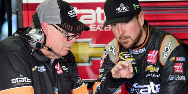 CHARLOTTE, NC - OCTOBER 08: Kurt Busch, driver of the #41 State Water Heaters Chevrolet, talks with his crew chief Tony Gibson in the garage area during practice for the NASCAR Sprint Cup Series Bank of America 500 at Charlotte Motor Speedway on October 8, 2015 in Charlotte, North Carolina. (Photo by Jared C. Tilton/NASCAR via Getty Images)