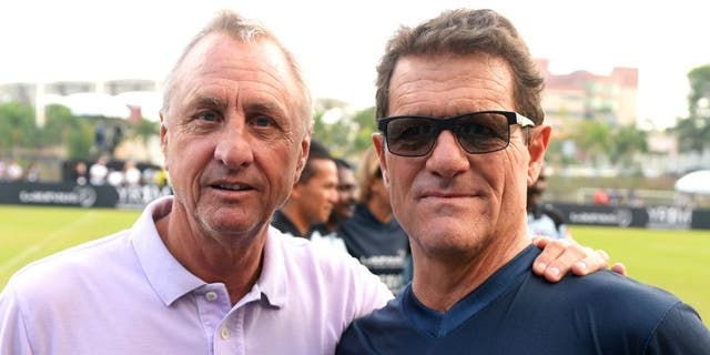 KUALA LUMPUR, MALAYSIA - MARCH 25: Johan Cruyff coach of Team YR1M and Fabio Capello coach of Team Laureus pose during the Laureus All Stars Unity Cup ahead of the 2014 Laureus World Sports Awards at Royal Selangor Club on March 25, 2014 in Kuala Lumpur, Malaysia. (Photo by Mike Hewitt/Getty Images for Laureus)