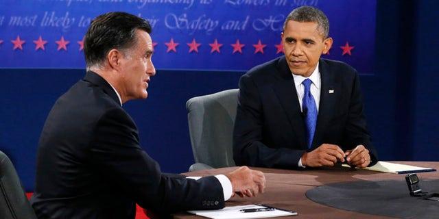 Oct. 22, 2012: President Barack Obama listens as Republican presidential nominee Mitt Romney speaks during the third presidential debate.