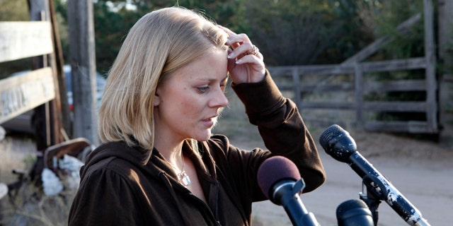 Oct. 23: Tiffany Hartley talks with the media at her parents home in LaSalle, Colo., after riding with them from Texas.