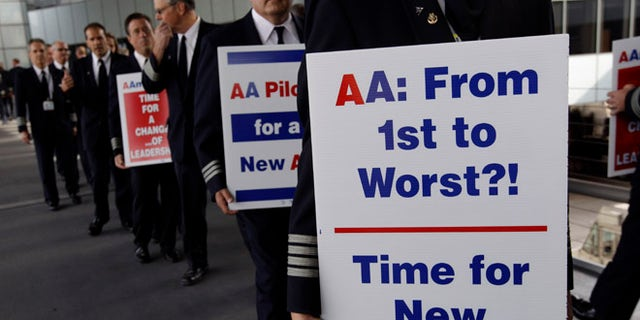 File: Sept. 20, 2012: Over 200 American Airline pilots march on a picket line at O'Hare International in Chicago, Ill.