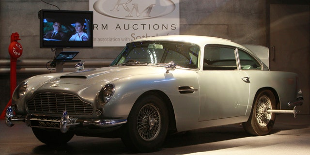 The 'James Bond' 1964 Aston Martin DB5, is viewed by the media, in London, Tuesday, Oct., 26, 2010. The car which was the road car in the Bond movie 'Goldfinger and the effects car in ' Thunderball ' both staring Sean Connery is expected to sell for around $5.5 million (euro3.9 million), at auction in London, Thursday, Oct. 27. (AP Photo/Alastair Grant)
