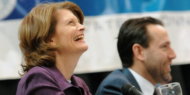 Oct. 26: Write-in Republican candidate Sen. Lisa Murkowski and Republican Joe Miller laugh during a debate in Anchorage.