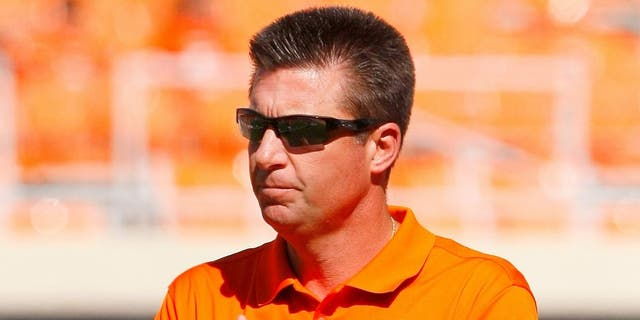 Oct 25, 2014; Stillwater, OK, USA; Oklahoma State Cowboys head coach Mike Gundy before the start of a game against West Virginia Mountaineers at Boone Pickens Stadium. Mandatory Credit: Alonzo Adams-USA TODAY Sports