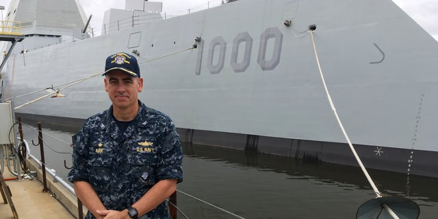 Capt. James Kirk, skipper of the future USS Zumwalt, standing in front of the destroyer on Tuesday.