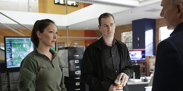 """React"" -- When Secretary of the Navy Sarah Porter learns her daughter has been kidnapped, the NCIS team partners with the FBI to track the case, determine a motive and bring her home. Alswo, McGee's (Sean Murray, center) childhood friend, NCIS Special Agent Valerie Page (Christina Chang, left), is in town to assist the team with advance tactics training, on NCIS, Tuesday, Feb 16 (8:00-9:00 PM, ET/PT), on the CBS Television Networkon NCIS, Tuesday, Feb 16 (8:00-9:00 PM, ET/PT), on the CBS Television Network. Pictured left to right: Christina Chang, Sean Murray, and Mark Harmon   Photo: Neil Jacobs/CBS  ©2016 CBS Broadcasting, Inc. All Rights Reserved"
