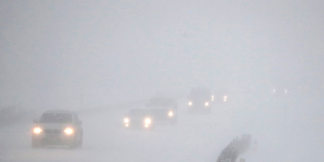 Vehicles commute southbound on the Garden State Parkway in whiteout conditions during a snowstorm, Thursday, Jan. 4, 2018, in Eatontown, N.J.