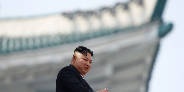 North Korean leader Kim Jong Un applauds during a military parade.