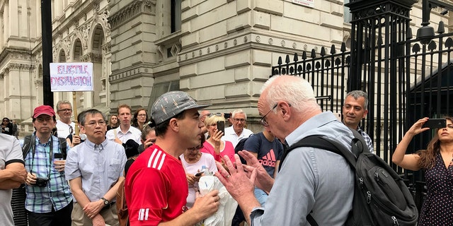 Trump supporters and opponents argue outside Downing Street.
