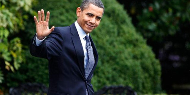 Sunday: President Obama waves as he leaves the White House for a day trip to New Jersey to campaign for Gov. Jon Corzine. (AP)