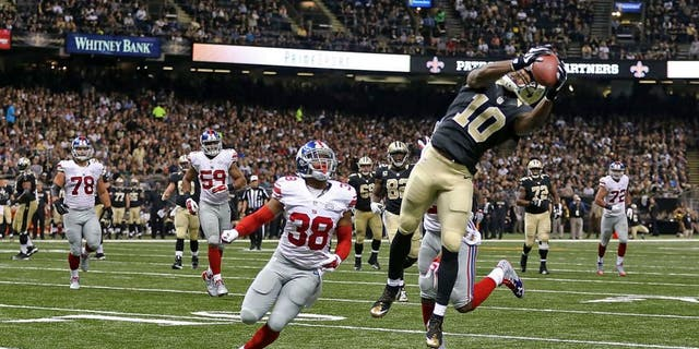NEW ORLEANS, LA - NOVEMBER 01: Brandin Cooks #10 of the New Orleans Saints catches a pass for a touchdown during the third quarter of a game against the New York Giants at the Mercedes-Benz Superdome on November 1, 2015 in New Orleans, Louisiana. (Photo by Chris Graythen/Getty Images)
