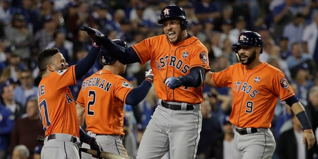 Houston Astros' George Springer reacts after hitting a two-run home run during the second inning of Game 7 of baseball's World Series against the Los Angeles Dodgers Wednesday, Nov. 1, 2017, in Los Angeles.