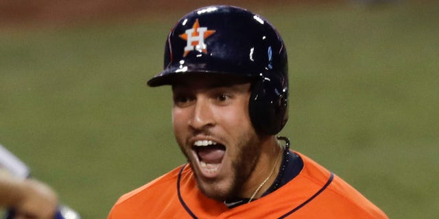 Houston Astros' George Springer (4) celebrates after his two-run home run against the Los Angeles Dodgers during the second inning of Game 7 of baseball's World Series Wednesday, Nov. 1, 2017, in Los Angeles.