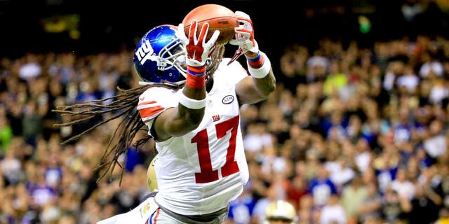 Nov 1, 2015; New Orleans, LA, USA; New York Giants wide receiver Dwayne Harris (17) catches a touchdown against the New Orleans Saints during the second half of a game at the Mercedes-Benz Superdome. The Saints defeated the Giants 52-49. Mandatory Credit: Derick E. Hingle-USA TODAY Sports