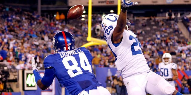 Nov 3, 2014; East Rutherford, NJ, USA; New York Giants tight end Larry Donnell (84) dives for touchdown pass over out stretched hands of Indianapolis Colts strong safety Mike Adams (29) during the second half at MetLife Stadium. Indianapolis Colts defeat the New York Giants 40-24. Mandatory Credit: Jim O'Connor-USA TODAY Sports