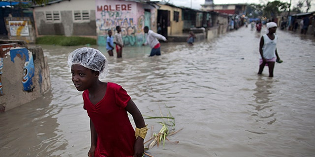 Nov. 6: People walk in a flooded street after the passing of Hurricane Tomas in the neighborhood of Cite Soleil in Port-au-Prince, Haiti.