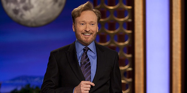 Nov. 8: In this photo provided by TBS, Conan O'Brien performs during the debut of his new TBS show 'Conan.'