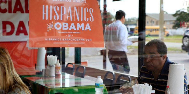 Oct. 26, 2012: Spanish language election campaign signs promoting President Barack Obama hang on the windows at Lechonera El Barrio Restaurant in Orlando, Fla. Hispanics supported President Barack Obama over Republican Mitt Romney by almost 3-to-1 and put Republicans on notice they must take real steps to win over the nations largest minority group if they want to win the presidency again.