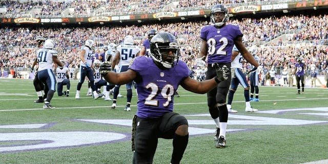 BALTIMORE, MD - NOVEMBER 09: Running back Justin Forsett #29 of the Baltimore Ravens celebrates after scoring a third quarter touchdown against the Tennessee Titans at M&T Bank Stadium on November 9, 2014 in Baltimore, Maryland. (Photo by Patrick Smith/Getty Images)