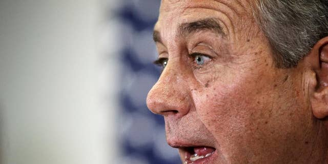 """House Speaker John Boehner of Ohio says Senate Democrats should """"get off their ass"""" and pass a bill to fund the Homeland Security Department and restrict President Barack Obama's executive moves on immigration, Wednesday, Feb. 11, 2015, during a news conference following a GOP strategy meeting, on Capitol Hill in Washington. His comments Wednesday underscored a worsening stalemate on Capitol Hill with funding for the Homeland Security Department set to expire Feb. 27. A day earlier, Senate Majority Leader Mitch McConnell declared the Senate """"stuck"""" on the issue and said the next move was in the House's court. (AP Photo/J. Scott Applewhite)"""