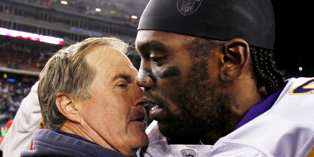 Oct. 31: New England Patriots coach Bill Belichick hugs Minnesota Vikings wide receiver Randy Moss after New England's 28-18 win in an NFL football game in Foxborough, Mass.