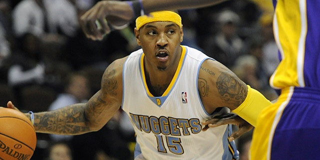 Nov. 11: Denver Nuggets forward Carmelo Anthony brings the ball up the floor in the second half of an NBA basketball game against the Los Angeles Lakers in Denver.