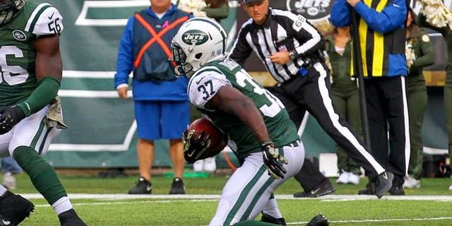Nov 9, 2014; East Rutherford, NJ, USA; New York Jets free safety Jaiquawn Jarrett (37) returns an interception thrown by Pittsburgh Steelers quarterback Ben Roethlisberger (7) (not shown) during the first half at MetLife Stadium. Mandatory Credit: Ed Mulholland-USA TODAY Sports