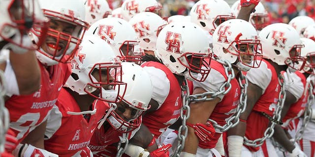Nov 7, 2015; Houston, TX, USA; The Houston Cougars players fire up the crowd prior to their game against the Cincinnati Bearcats at TDECU Stadium. The Cougars won 33-30. Mandatory Credit: Thomas B. Shea-USA TODAY Sports