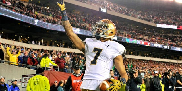 Oct 31, 2015; Philadelphia, PA, USA; Notre Dame Fighting Irish wide receiver Will Fuller (7) reacts after scoring a touchdown against the Temple Owls during the second half at Lincoln Financial Field. Notre Dame won the game 24-20. Mandatory Credit: Derik Hamilton-USA TODAY Sports