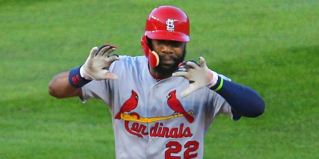 Oct 12, 2015; Chicago, IL, USA; St. Louis Cardinals right fielder Jason Heyward (22) celebrates after hitting a double during the second inning in game three of the NLDS against the Chicago Cubs at Wrigley Field. Mandatory Credit: Dennis Wierzbicki-USA TODAY Sports