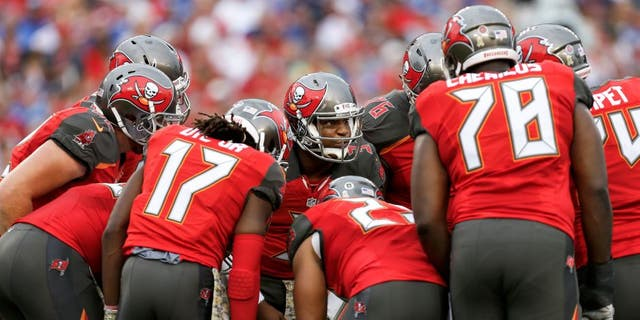 TAMPA, FL - NOVEMBER 8: Quarterback Jameis Winston #3 of the Tampa Bay Buccaneers calls a play in the huddle during the game against the New York Giants at Raymond James Stadium on November 8, 2015 in Tampa, Florida. The Giants defeated the Buccaneers 32 to 18. (Photo by Don Juan Moore/Getty Images)