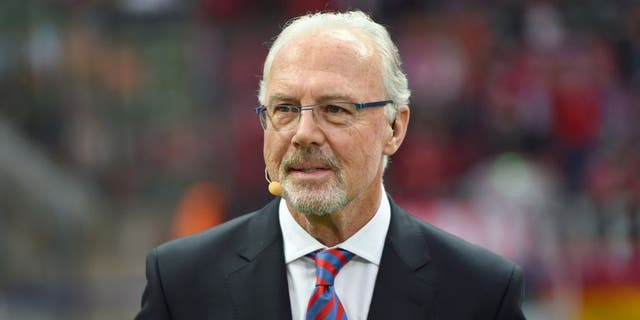 German football legend Franz Beckenbauer attends the DFB German Cup final football match BVB Borussia Dortmund vs Bayern Munich at the Olympic Stadium in Berlin on May 17, 2014. AFP PHOTO / PATRIK STOLLARZ RESTRICTIONS / EMBARGO ACCORDING TO DFB RULES IMAGE SEQUENCES TO SIMULATE VIDEO IS NOT ALLOWED DURING MATCH TIME. MOBILE (MMS) USE IS NOT ALLOWED DURING AND FOR FURTHER TWO HOURS AFTER THE MATCH. FOR MORE INFORMATION CONTACT DFB DIRECTLY AT +49 69 67880 (Photo credit should read PATRIK STOLLARZ/AFP/Getty Images)