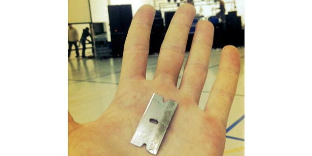 The razor blade Jonathan handed over to Nick Hall.