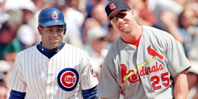 Mark McGwire and Sammy Sosa were chasing Roger Maris in 1998. (JOHN ZICH/AFP/Getty Images)