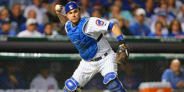October 20, 2015; Chicago, IL, USA; Chicago Cubs relief catcher Miguel Montero (47) throws to first in the sixth inning against the New York Mets in game three of the NLCS at Wrigley Field. Mandatory Credit: Dennis Wierzbicki-USA TODAY Sports
