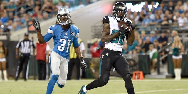 JACKSONVILLE, FL - AUGUST 28: Allen Hurns #88 of the Jacksonville Jaguars catches a pass for a touchdown in front of Rashean Mathis #31 of the Detroit Lions during the first quarter of a preseason game at EverBank Field on August 28, 2015 in Jacksonville, Florida. (Photo by Stacy Revere/Getty Images)