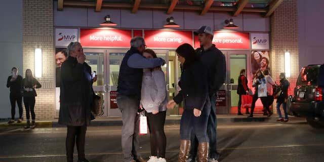 Nov. 12, 2016: People embrace after leaving Crossgates Mall in Guilderland, N.Y., after reports of gunfire inside.