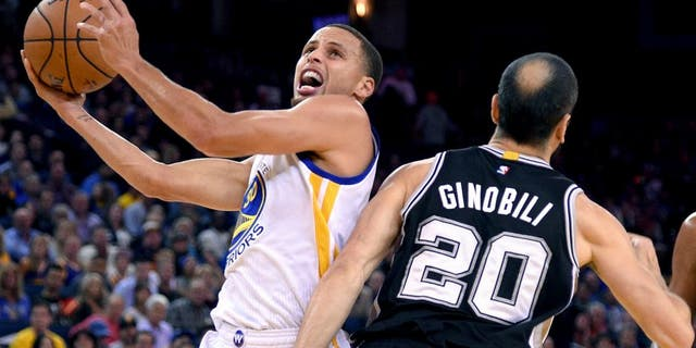 Nov 11, 2014; Oakland, CA, USA; Golden State Warriors guard Stephen Curry (30, left) shoots the ball against San Antonio Spurs guard Manu Ginobili (20) during the first quarter at Oracle Arena. Mandatory Credit: Kyle Terada-USA TODAY Sports