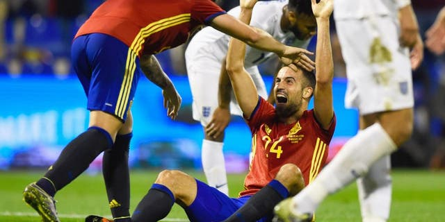 ALICANTE, SPAIN - NOVEMBER 13: Mario Gaspar of Spain (24) celebrates with Paco Alcacer Garcia (9) as he scores their first goal during the international friendly match between Spain and England at Jose Rico Perez Stadium on November 13, 2015 in Alicante, Spain. (Photo by Mike Hewitt/Getty Images)