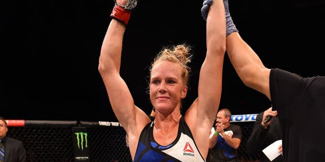 SAN DIEGO, CA - JULY 15: Holly Holm celebrates her victory over Marion Reneau in their women's bantamweight bout during the UFC event at the Valley View Casino Center on July 15, 2015 in San Diego, California. (Photo by Jeff Bottari/Zuffa LLC/Zuffa LLC via Getty Images)