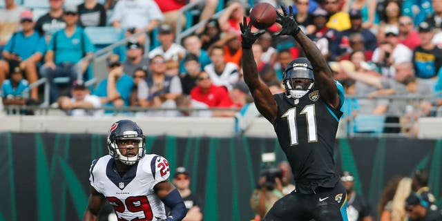 Jacksonville Jaguars wide receiver Marqise Lee (11) makes a reception over Houston Texans free safety Andre Hal (29) during the first half of an NFL football game in Jacksonville, Fla., Sunday, Nov. 13, 2016. (AP Photo/Stephen B. Morton)