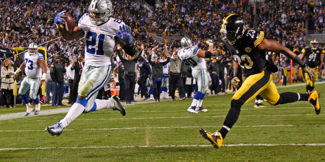 Dallas Cowboys running back Ezekiel Elliott (21) rushes for a touchdown with Pittsburgh Steelers free safety Mike Mitchell (23) defending during the second half of an NFL football game in Pittsburgh, Sunday, Nov. 13, 2016. (AP Photo/Don Wright)