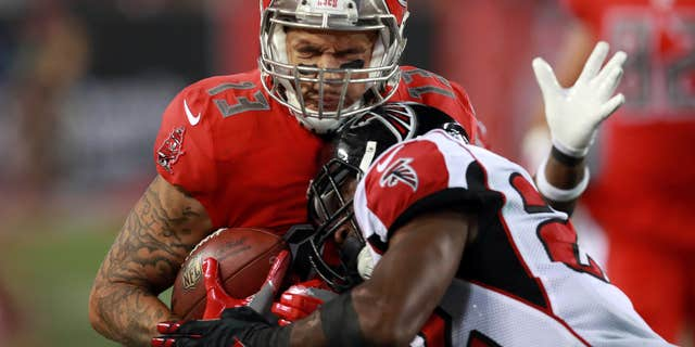 FILE - In this nov. 3, 2016, file photo, Tampa Bay Buccaneers wide receiver Mike Evans (13) makes catch as Atlanta Falcons safety Keanu Neal (22) tackles him during an NFL football game in Tampa, Fla.